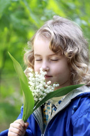 Lovely girl smell the flowers photo