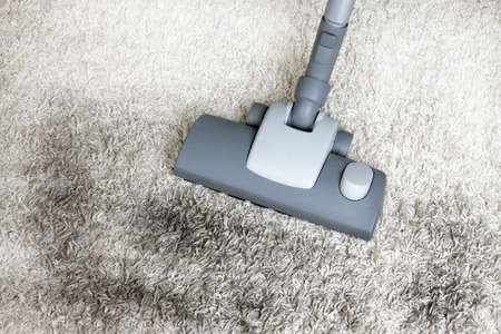 Vacuuming very dirty white carpet  photo
