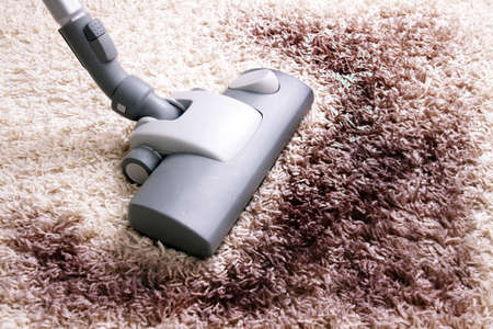 Vacuuming very dirty white carpet Stock Photo - 13739974