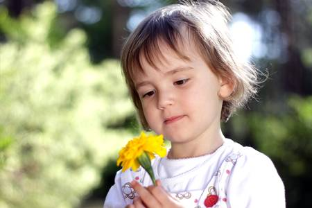 Lovely girl with yellow flower Stock Photo - 13826380