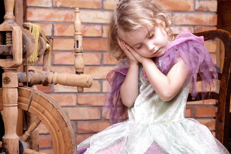 chambers: Adorable little girl playing in the story of the sleeping princess
