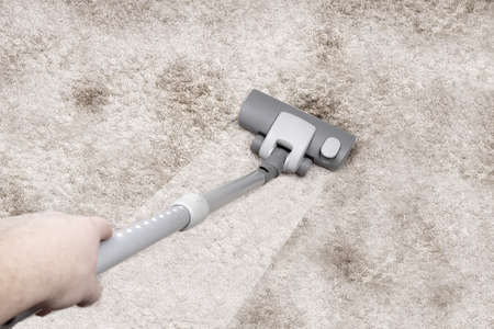 disarray: Vacuuming the carpet Stock Photo