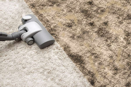 Vacuuming dirty carpet Stock Photo - 18936644