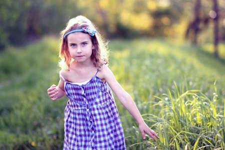 little girl in a meadow photo