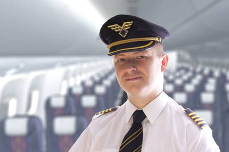 epaulets: The pilot in the cabin waiting for passengers