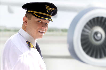 Cheerful pilot against the huge engine aircraft photo