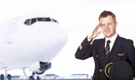 epaulets: Pilot saluting in front of airplane  Stock Photo