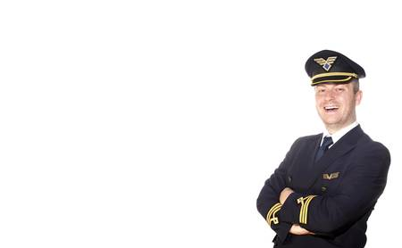 Airliner pilot in uniform on white background photo