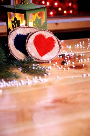 Two wooden hearts in a romantic christmas atmosphere Two wooden hearts in a romantic christmas atmosphere Stock Photo - 22062241
