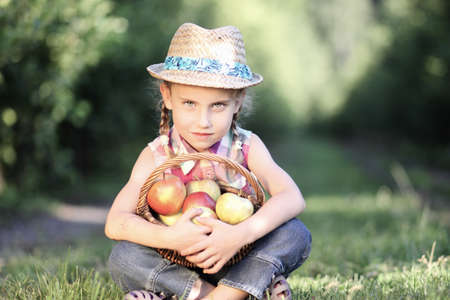 Girl with the apple basket photo