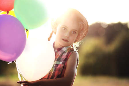 Summer time - girl with the balloons photo