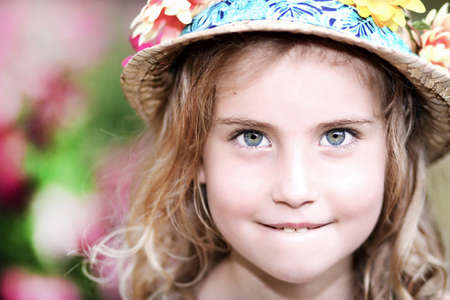 spring girl in hat with flowers photo