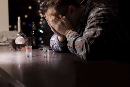 rejection sad: Sad man with problems sitting at the bar