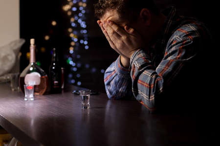 rejection sad: Alcoholic in bar