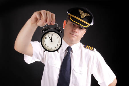 Upset pilot waiting for late passengers 免版税图像