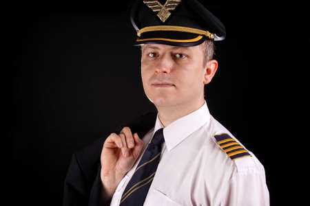 epaulets:  Portrait of a young captain in uniform on a black background