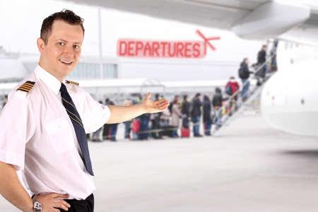 epaulets:  Captain invites passengers on board aircraft Stock Photo
