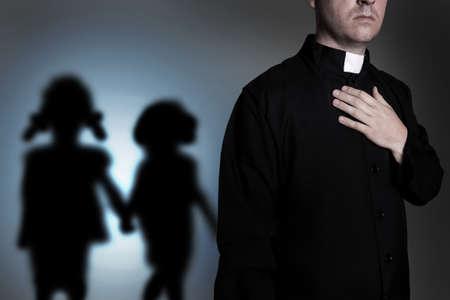 priest and shadow children Stockfoto