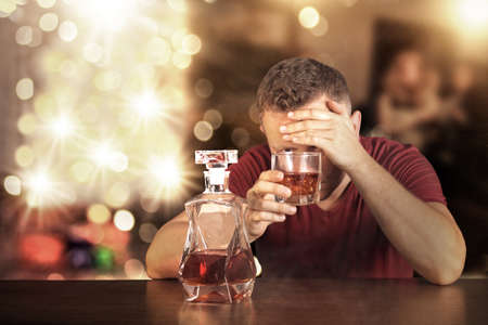 complications: Drunk man at home during the Christmas Stock Photo