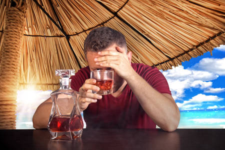 drunk party: Man  drinking on vacation Stock Photo