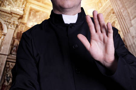 white collars: The greeting priest