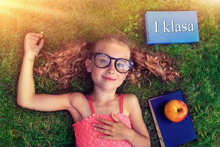 lying on back: Back to school - first class Stock Photo