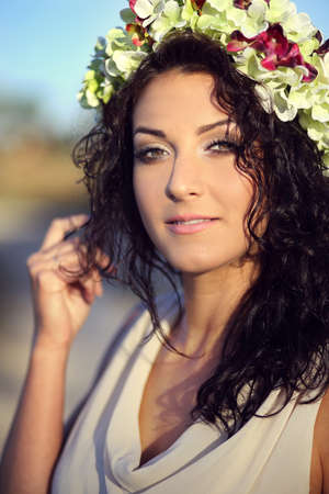 maquillage: Pretty young girl in a wreath of flowers Stock Photo
