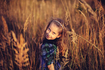 Pretty young girl walks on a glade photo