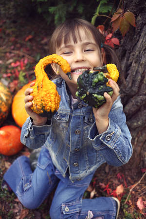 life jackets: The girl in a denim jacket in a forest in autumn day Stock Photo