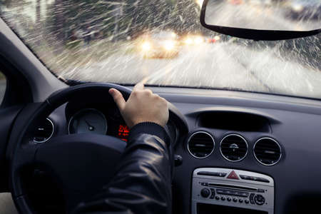 Driving: The winter weather on the way - falling snow  Stock Photo