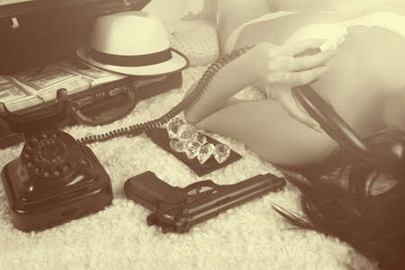 Retro time - bad girl calling by phone photo