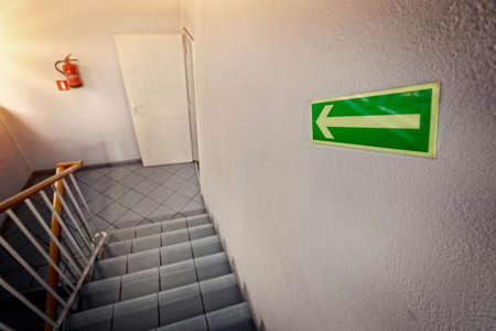 fire exit sign: emergency exit staircase Stock Photo