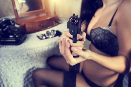 bank robber: Bad girl aims from a gun