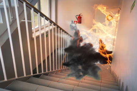 fire safety: Fire in building - emergency exit