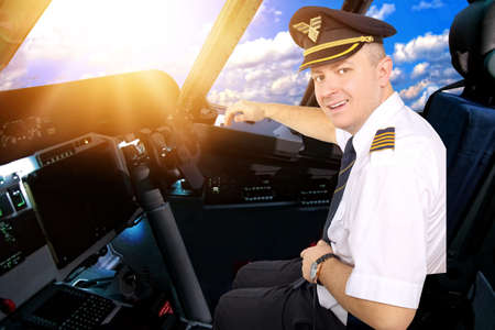 epaulets: Smiling and cheerful pilot in the cockpit of an airliner Stock Photo