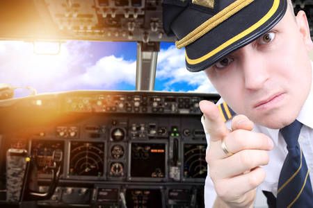 intolerable: Furious pilot draws attention to the intolerable passengers Stock Photo