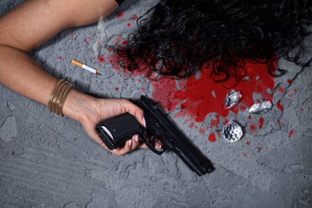 cold blooded: Cold blooded murder-woman after the attack lies in a pool of blood Stock Photo