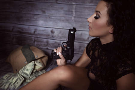 scruples: Girl with a gun after the attack hiding