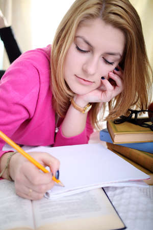 The girl writes a note in notebook photo