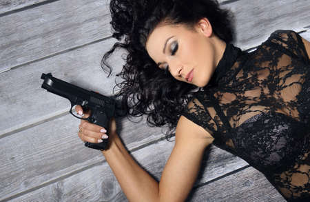 sexy police: Bad brunette girl with gun