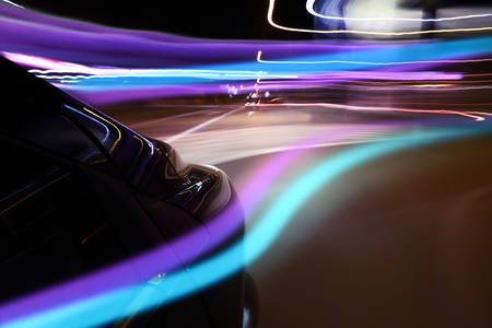 Car at night with neon light - abstract photo