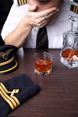 Drunk crying pilot with problems Stock Photo