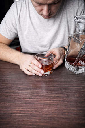 complications: Drunk man in bar Stock Photo