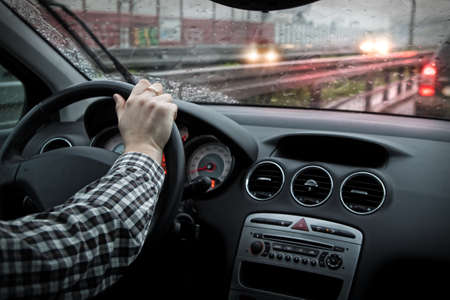 Rainy weather on the road and slow driving in traffic Stock Photo