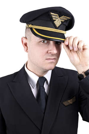 fidgety: Serious young pilot in uniform on a white background Stock Photo