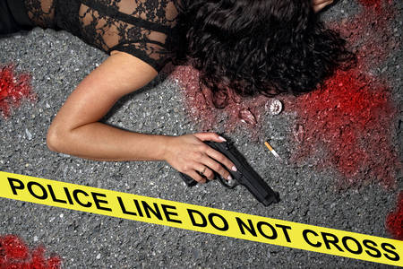 Murder on the street - a woman with a gun in the blood Stock Photo