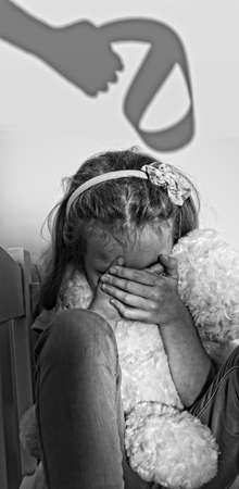 tortured: frightened children huddled Stock Photo