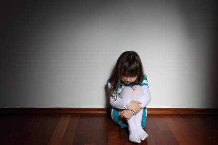 bully: Frightened young girl Stock Photo