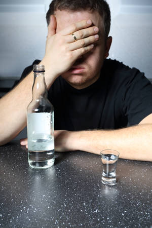 drinking problem: Alcohol problem - helpless man drinking vodka Stock Photo