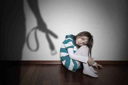 Domestic violence - sad lonely youth girl Stock Photo